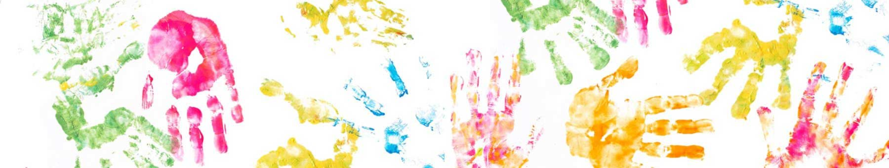 Children's hand prints in bright colors