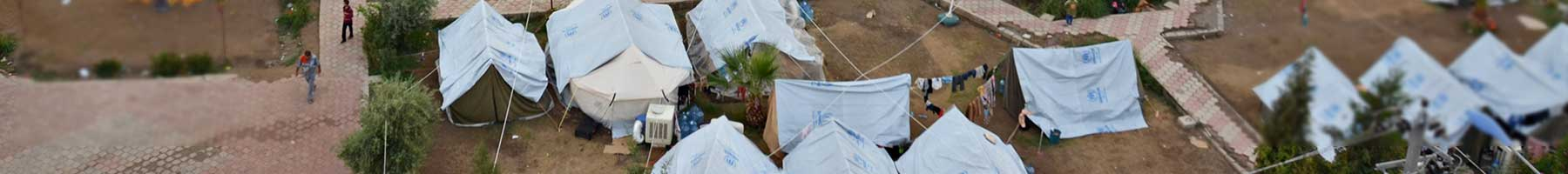 white tents in a refugee camp