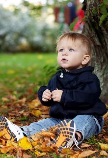 A baby in the Autumn leaves