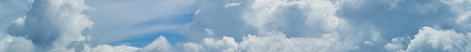 blue sky with white puffy clouds background texture