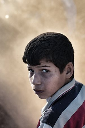 Photograph of a sad boy by Aris Messinis / Getty Images
