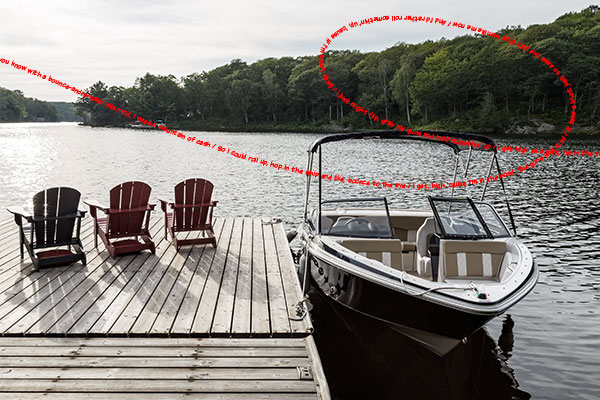 photo of a boat by a dock with red text of a rap song overlaid